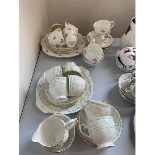 289 - 21-piece Queen Anne green tea set and 21-piece Albany tea set