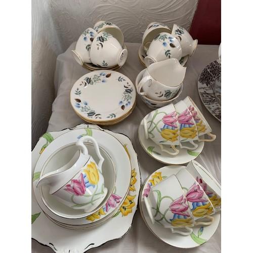 276 - 20 piece Colclough tea service and 21 piece English Tulip tea service