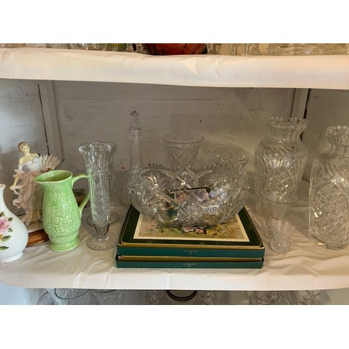 279 - Shelf of cut glassware, china and table mats