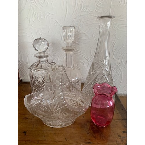 265 - 3 cut glass decanters, cut glass basket and Cranberry glass vase (5)