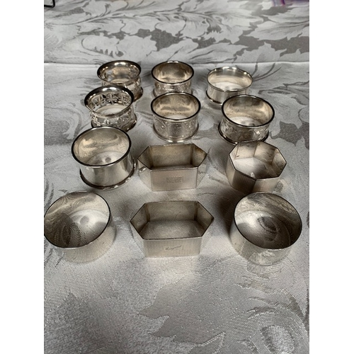 144C - 12 Victorian and later silver napkin rings - 230 gms
