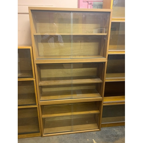 499 - 3 modern 3ft glazed bookcase each with 2 glazed doors and shelf, total height of 3 bookcases is 5'8