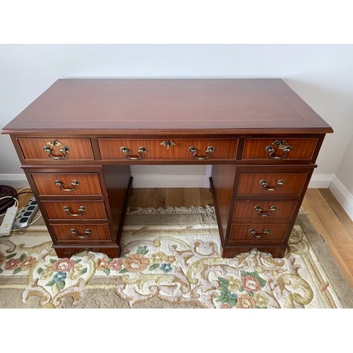 508 - Reproduction inlaid mahogany knee-hole desk, 3 top drawers over 2 columns of 3 drawers 48