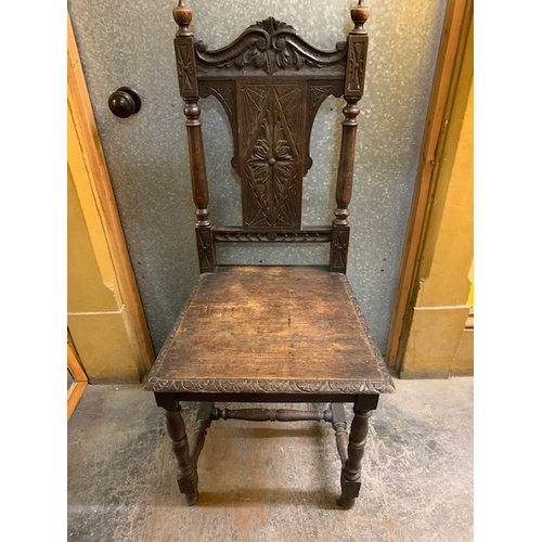 494 - Carved oak hall chair