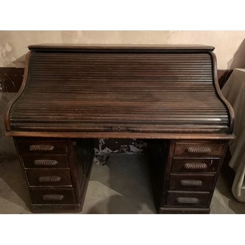 576 - Victorian oak roll top desk with well fitted interior, 60