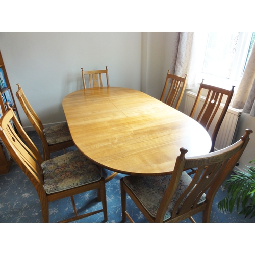 588 - Good quality Ercol 'Saville' 7ft extending dining table together with 6 matching dining chairs