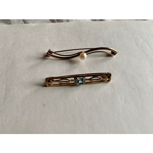 171 - Two 9ct gold tie pins, one with central pearl and one with central light blue stone, total 4.1gms