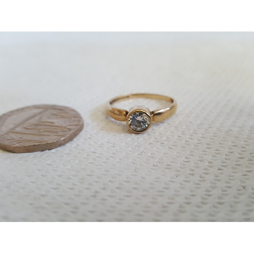 32 - 9ct gold ring...