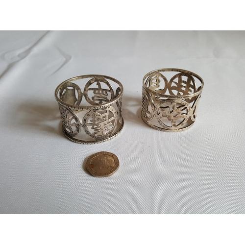44 - 2 HM silver napkin rings...