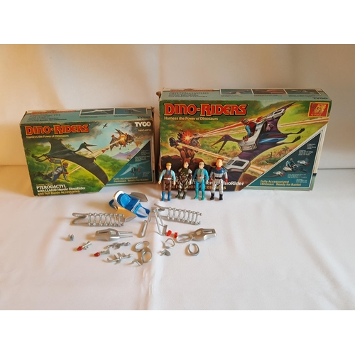 46 - a quantity of Tyco Dino Riders accessories & 2 empty boxes...