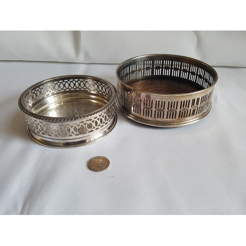 21 - 2 silver plated bottle coasters...