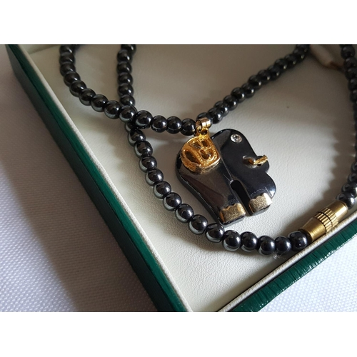 31 - black jade pendant necklace...