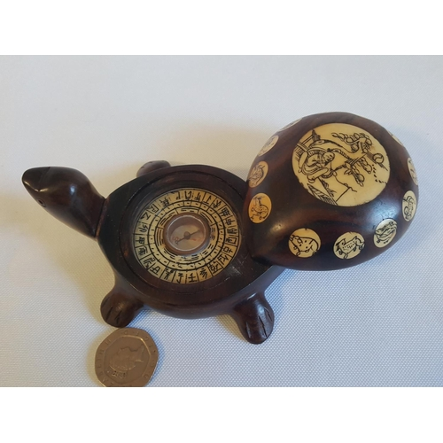 2 - Chinese year of animals with compass in shape of turtle