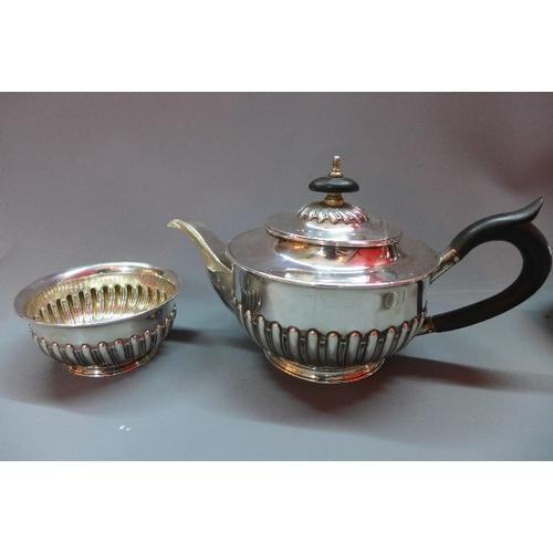1 - A Victorian silver tea set, to include a teapot and hot water pot with gadrooned decoration and ebon...