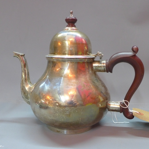 22 - A silver three piece tea set, comprising a teapot with wooden handle and finial, a milk jug and a su...