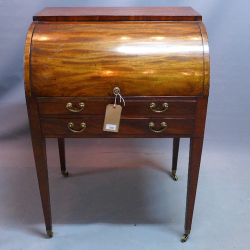 300 - A 19th century mahogany cylindrical bureau with roll top enclosing three maple wood drawers and pull...