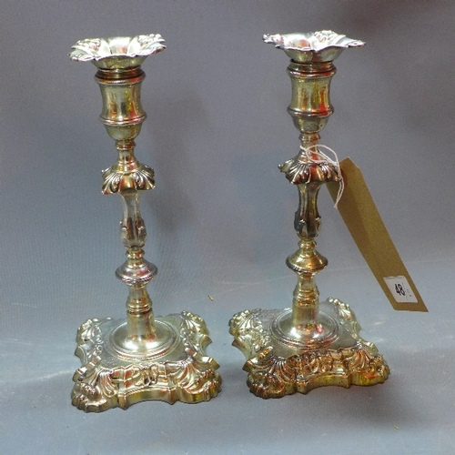 48 - A pair of Georgian silver candlesticks, with shell and foliate design, William Cafe, London 1763, ap...