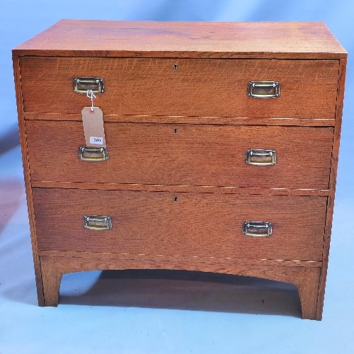 309 - An Arts and Crafts chest of three graduated drawers raised on bracket feet. H.84cm W.92cm D.53cm...