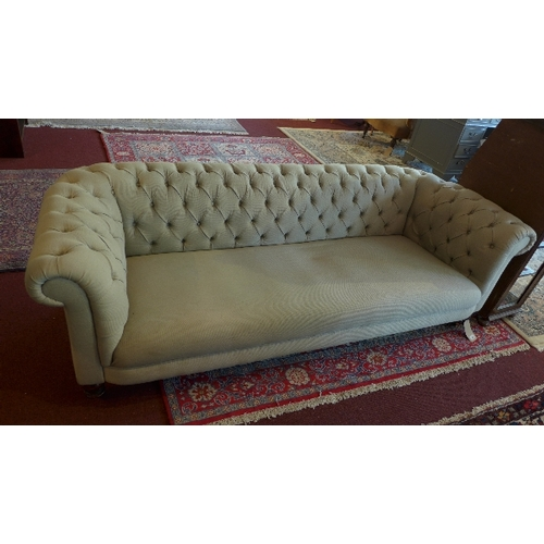344 - A grey three seater Chesterfield sofa, L.200 H.65 D.85cm...