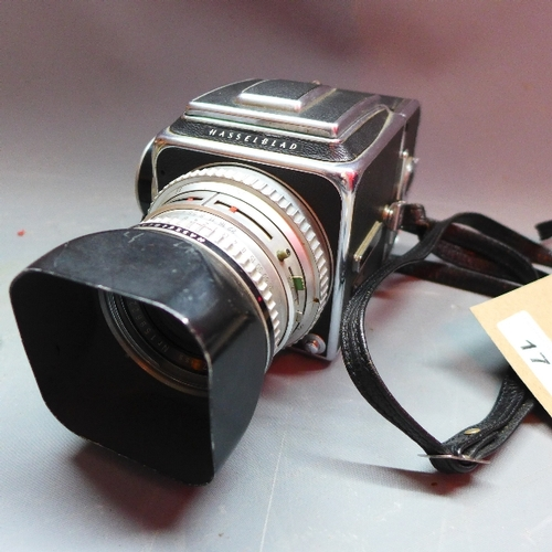 17 - A Hasselblad 500C camera, serial no. TS40924, with a Carl Zeiss Planar 1:2.8 f=80mm lens, and a Hass...