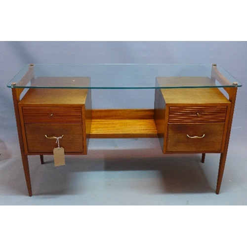 362 - A mid 20th century teak desk, with glass top above four drawers, raised on tapered legs, H.75 W.127 ...