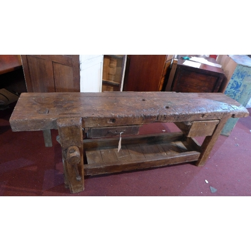 322 - A late 19th century elm work bench, H.73 W.205 D.45cm...