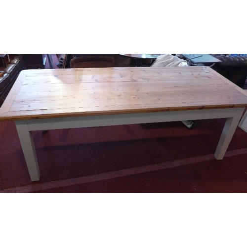 376 - An early 20th century pine farmhouse dining table, with cream painted base, raised on tapered legs, ...