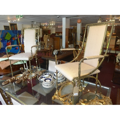 355 - A set of eight 1970's Italian designer gilt metal dining chairs, to include two carvers...