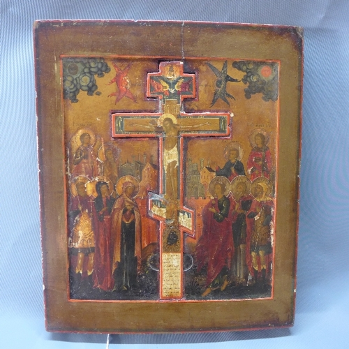 22 - A Russian icon of the Crucifixion, Jesus to centre on inset crucifix surrounded by mourners, includi...