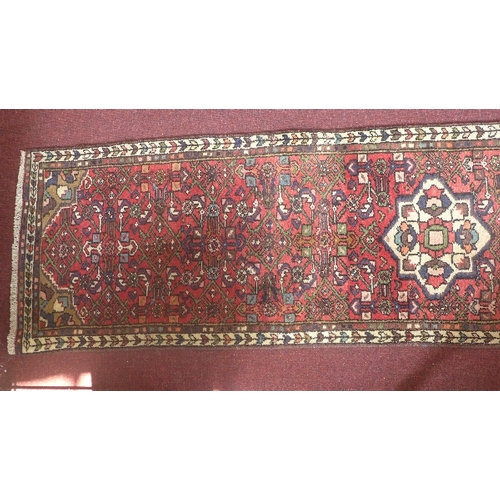 70 - A fine North West Persian Malayer runner, repeating Herati motifs on a terracotta field complimented...