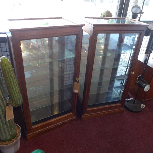 326 - A pair of 20th century mahogany shop display cabinets, with mirrored backs, having adjustable glass ...