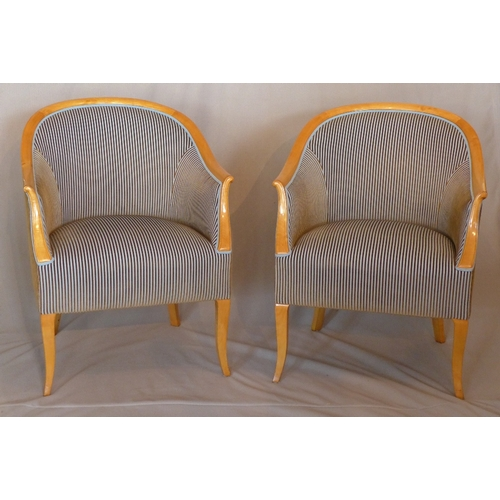 1021 - A pair of Biedermeier maple wood tub chairs, with corduroy upholstery, raised on sabre legs...