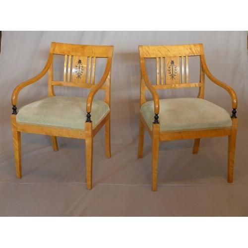 1022 - A pair of Biedermeier maple wood armchairs, raised on tapered legs...