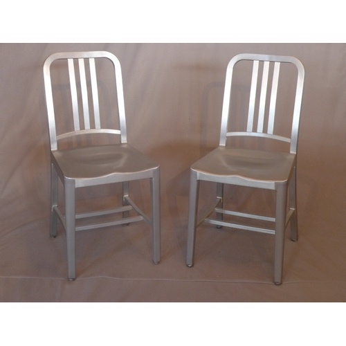 1029 - A pair of contemporary brushed aluminium Emeco navy chairs...