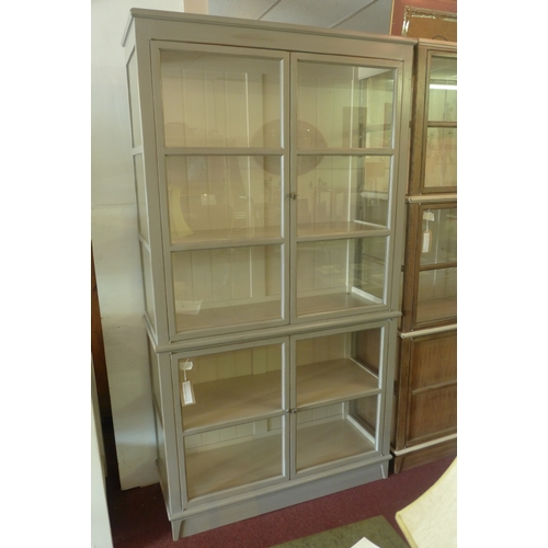 1031 - A grey painted Roche Bobois glass fronted display cabinet, with astral glazed doors, H.227 W.122 D.4...