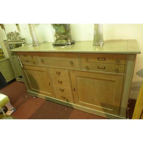 1038 - A Roche Bobois sideboard, having three drawers above two cupboard doors flanking central door with f...
