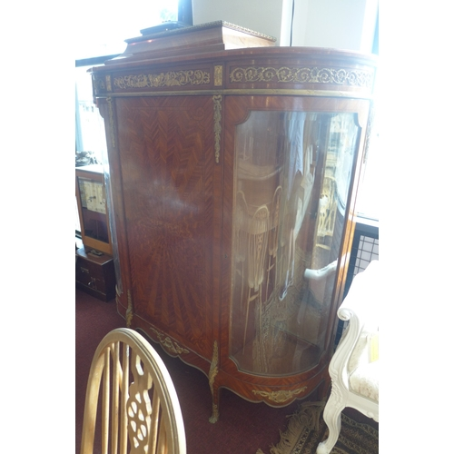1023 - A large French Empire kingwood credenza, circa 1900, central door flanked by two bowed bevelled glas...