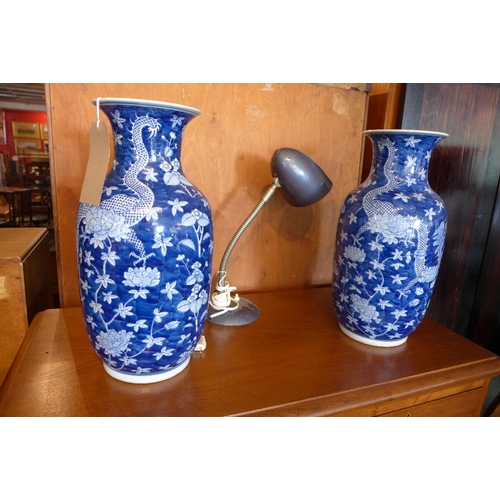27 - A pair of late 19th century Chinese blue and white porcelain vases, decorated with four clawed drago...