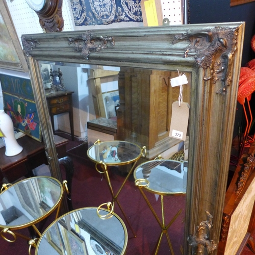 373 - A large gilt mirror, with C-scroll decorated frame, bevelled glass plate, 148 x 115cm...