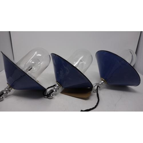 44 - A set of three Lassco blue and white enamelled ceiling light pendants...