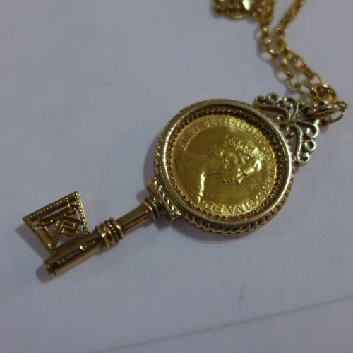 2 - An Elizabeth II 1982 gold half sovereign, mounted in 9ct yellow gold key pendant, on a 9ct yellow go...