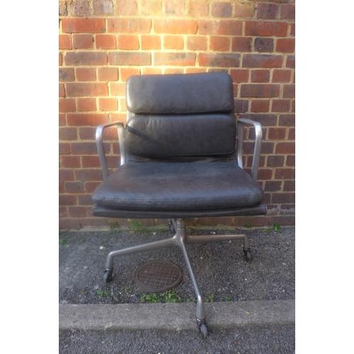 170 - A Charles Eames for Herman Miller black leather desk chair, on castors...