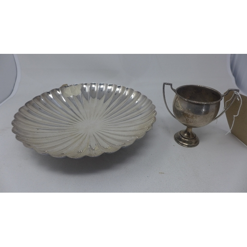 35 - A tennis winners' silver cup, H.12cm, together with a silver plate scalopped form dish (2)...
