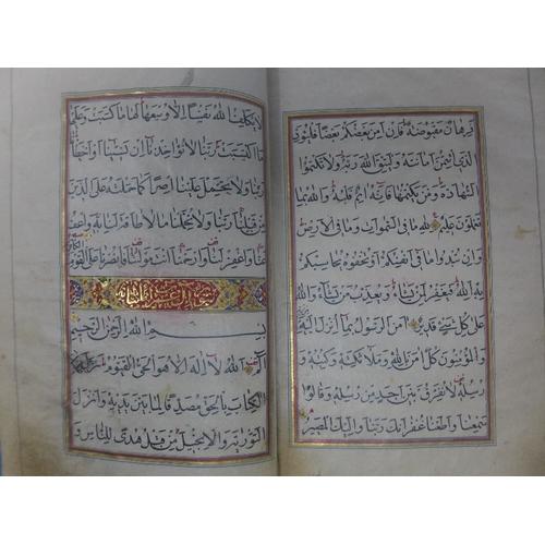 49 - Two mid-19th Century Persian Qujar period handwritten leather bound book, handwritten in Arabic, alo...