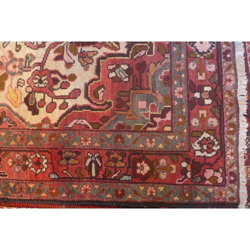 64 - A north west Persian Borchalue rug, with a central floral medallion with repeating floral medallion ...