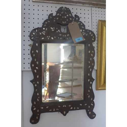 10 - An early 1900s Liberty Syrian wall mirror, the bevelled glass plate within a mother of pearl inlaid ...