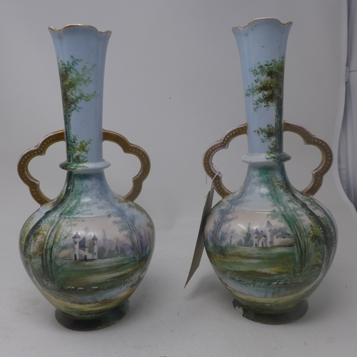 23 - A pair of late 19th century Continental twin handled vases, decorated with landscape scenes, H.33cm ...