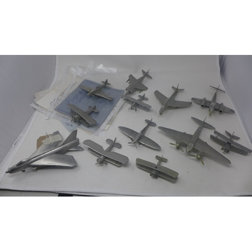 29 - A collection of twelve modern pewter Danbury Mint collectors planes, to include Supermarine Spitfire...