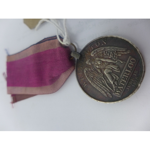 4 - An 1815 Waterloo medal, awarded to John Curtis, 11th Regiment Light Dragoons...