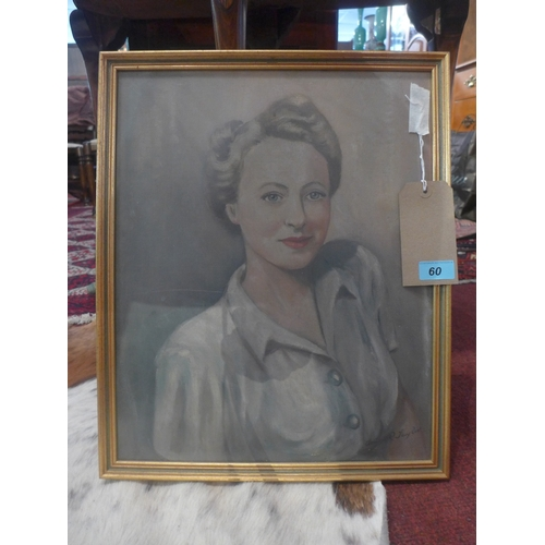 60 - A 20th Century oil on board portrait of a lady with blonde hair, signed lower right, framed and glaz...